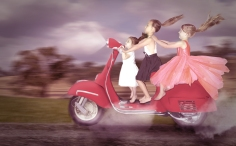 three girls and a scooter